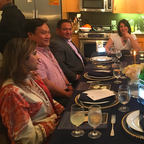 Seven diners gathered at the home of Veronica Perez, center, on Tuesday night in downtown L.A.