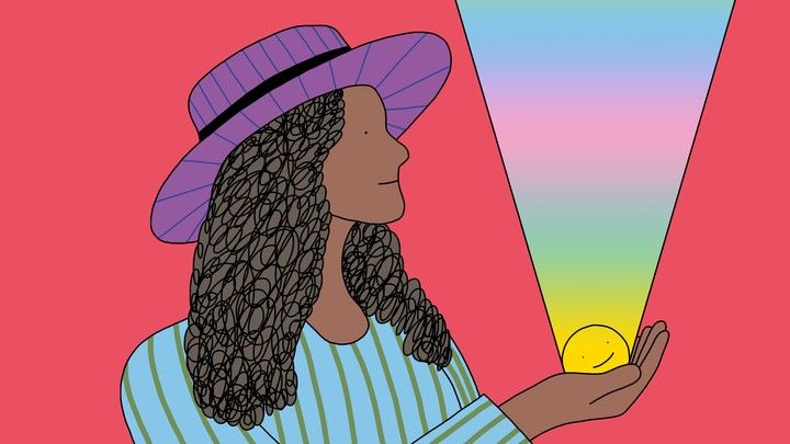 A woman stands holding a smiley face in her palm; a rainbow beam of light emanates from the smiley face to the heavens.