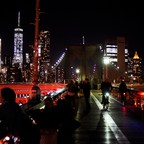 Pedestrians on a bridge linking Brooklyn and Manhattan.