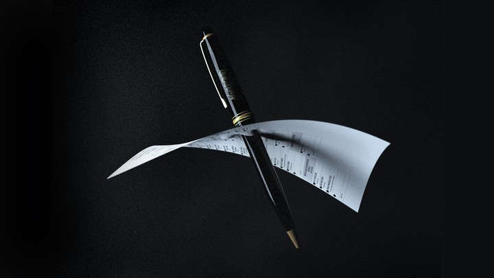 A black pen pierces a ballot