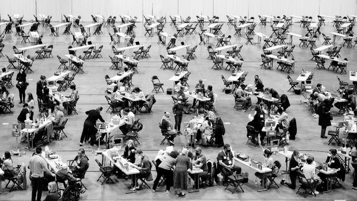 People receiving vaccines at a mass vaccination site in Seattle, Washington.