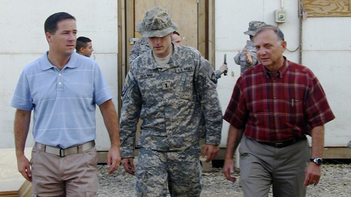 Lt. Michael C. Behenna, center, walked out of a courtroom flanked by his defense attorneys in 2008.