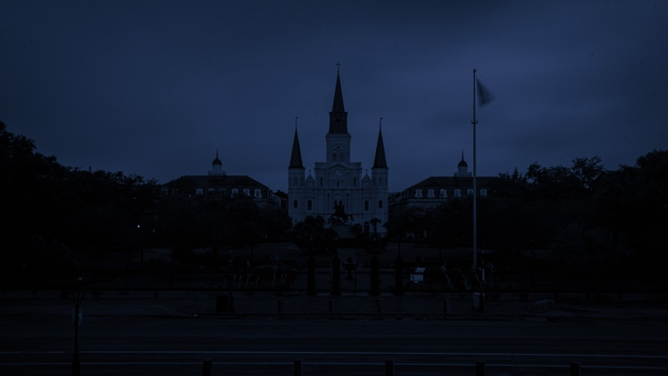 A dark image of Saint Louis Cathedral in New Orleans without electricity