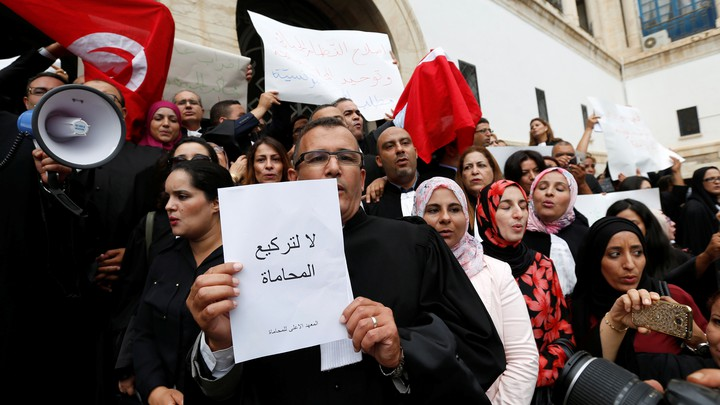 Tunisian lawyers gather as they demonstrate against the government's proposed new taxes, near the courthouse, in Tunis, Tunisia October 21, 2016.