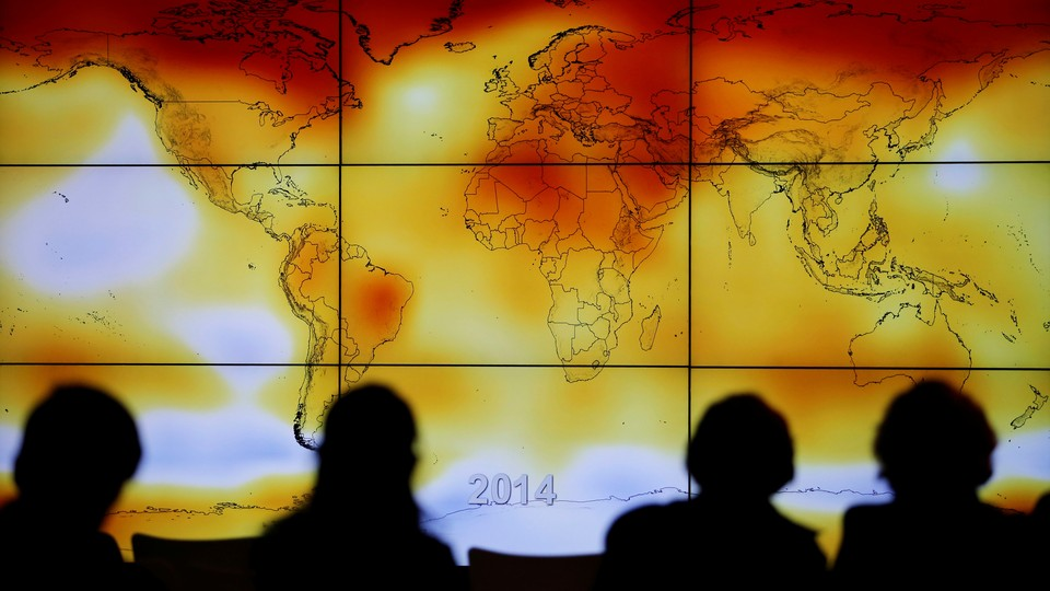 A screen showing a world map with climate anomalies during the World Climate Change Conference 2015 (COP21) at Le Bourget, near Paris, on December 8, 2015