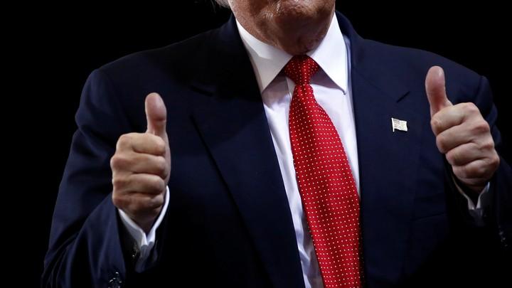 Trump gives thumbs-up.