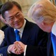 Donald Trump shakes hands with South Korean President Moon Jae-in.