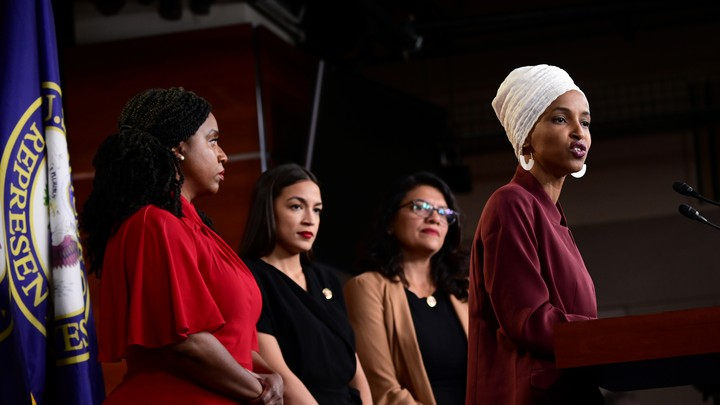 From right: Representatives Ilhan Omar, Rashida Tlaib, Alexandria Ocasio-Cortez, and Ayana Pressley speak at a press conference.