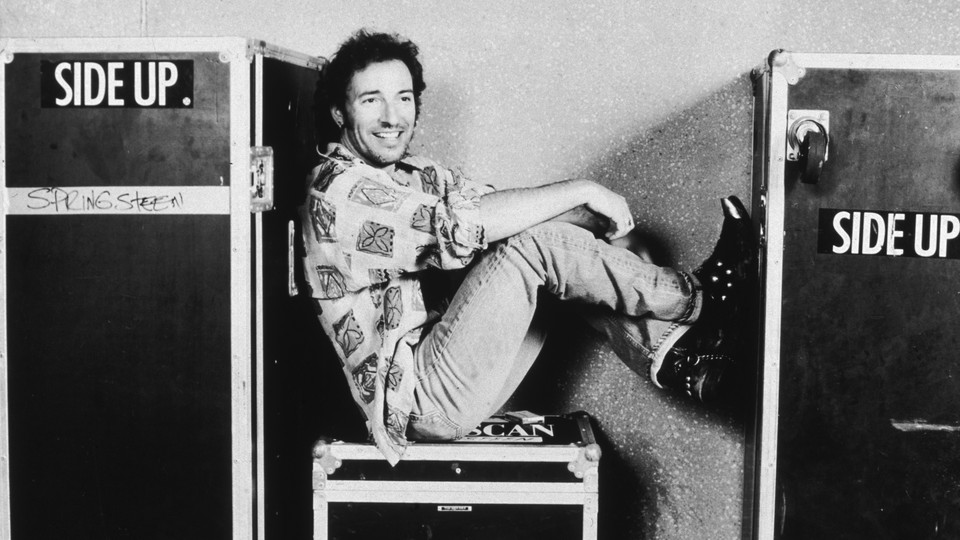 Bruce Springsteen sitting smiling