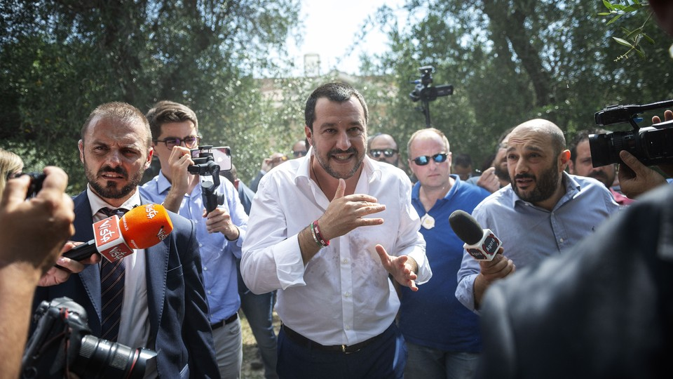 Italian Interior Minister Matteo Salvini answers questions from the media.