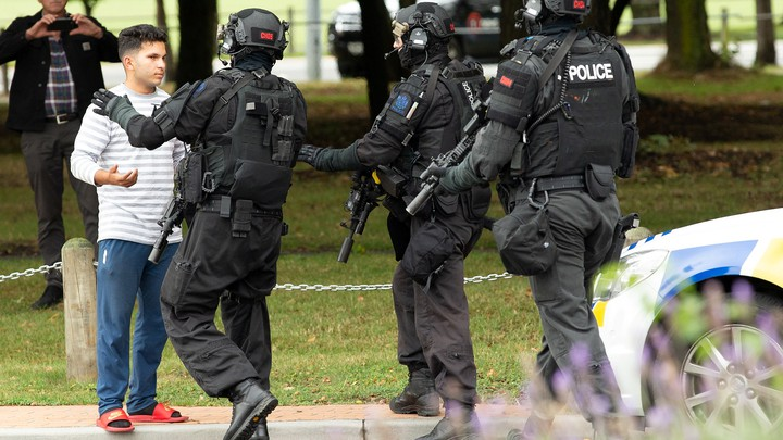 New Zealand police push back members of the public after the shooting at the Masjid Al Noor mosque in Christchurch.