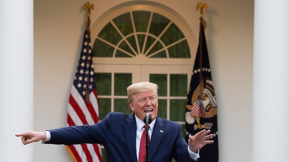 President Donald Trump pointing to the left during a coronavirus-task-force meeting in the Rose Garden
