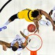 The UMBC Retrievers forward Daniel Akin (30) shoots the ball against Kansas State Wildcats forward Levi Stockard III (34) during the first half in the second round of the 2018 NCAA Tournament at Spectrum Center