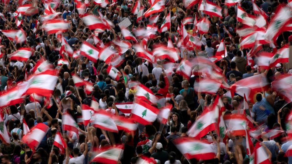Demonstrators wave Lebanese national flags