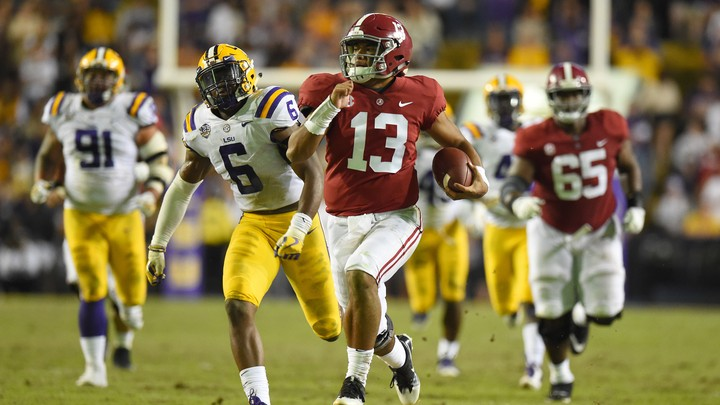 Alabama Crimson Tide quarterback Tua Tagovailoa (13) carries for a 44-yard touchdown against the LSU Tigers during the third quarter at Tiger Stadium.