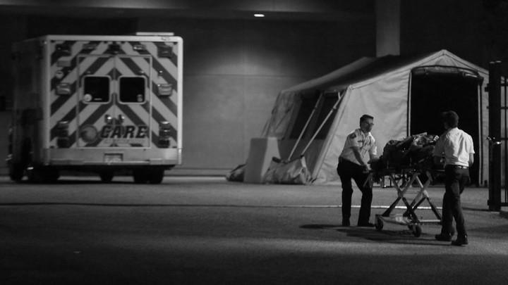 Paramedics bring a patient into the hospital.