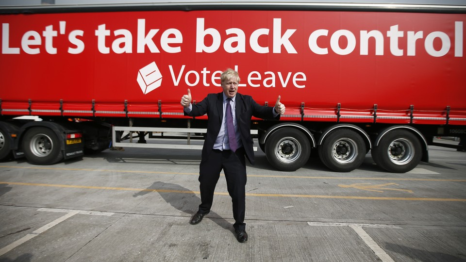 London Mayor Boris Johnson gestures in front of a Leave campaign bus