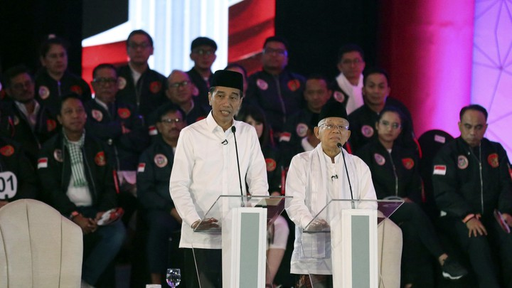 Jokowi and his running mate speak at Indonesia's first presidential debate ahead of April's elections.