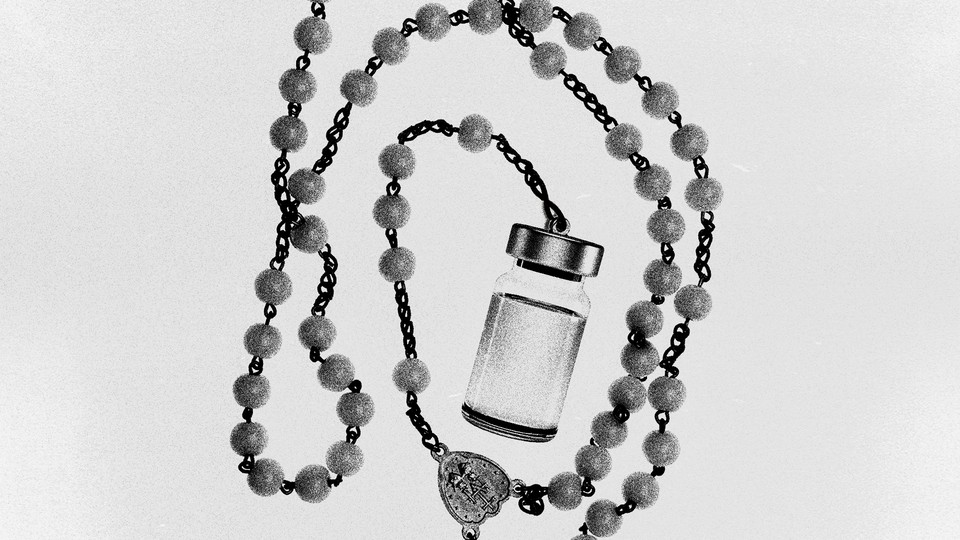 A black-and-white rosary that ends with a vaccine bottle