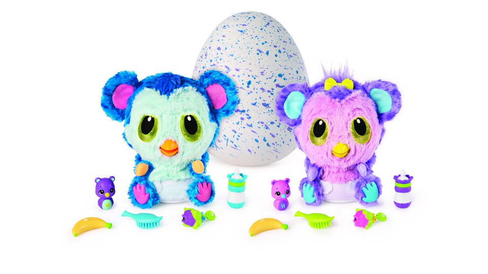 A pair of Hatchibabies toys are displayed alongside their many accessories.