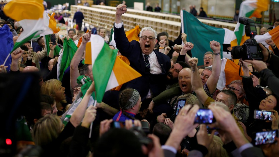 A Sinn Fein candidate celebrates with supporters after the announcement of voting results in Ireland's national election.