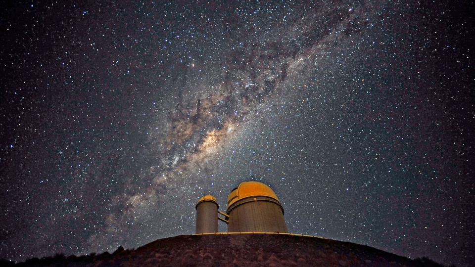 The Milky Way glitters in the night sky above a space observatory in Chile.