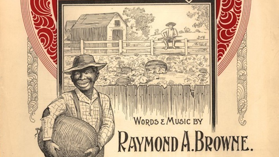 A vintage sign featuring a caricature of a Black man holding a watermelon