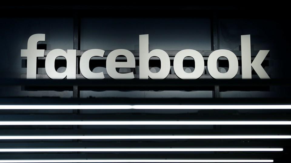 A black-and-white Facebook logo