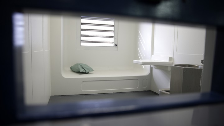 A jail cell in an enhanced supervision housing unit on Rikers Island, seen through a slot in the door