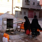 In Oct. 2017, women filled bottles with water in Zagora, Morocco during a water shortage.  Experts blamed the shortage on growing populations, climate change and agricultural choices.