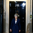 A photo of British Prime Minister Theresa May announcing her government's Brexit deal outside No. 10 Downing Street