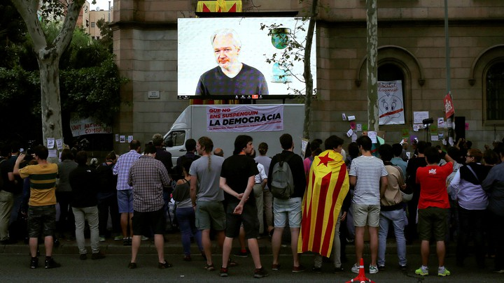 Via video conference, Julian Assange addresses supporters of the Catalonian independence referendum in 2017.