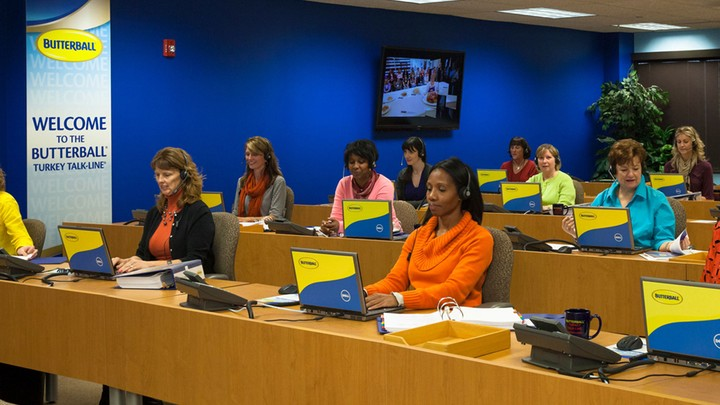 Employees use laptops, phones, and headsets at the Butterball call center.