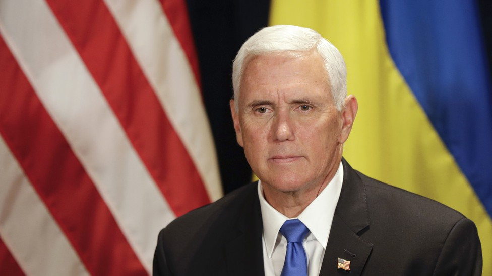 Vice President Mike Pence in front of the American and Ukrainian flags