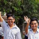 Reuters reporters Wa Lone and Kyaw Soe Oo walk to Insein prison gate after being freed.