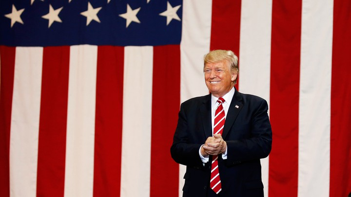 Donald Trump in front of the American flag