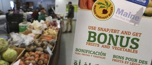 A farmers' market in Maine advertises a SNAP-related program.