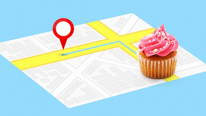 A street map with a destination pin and a cupcake overlaid