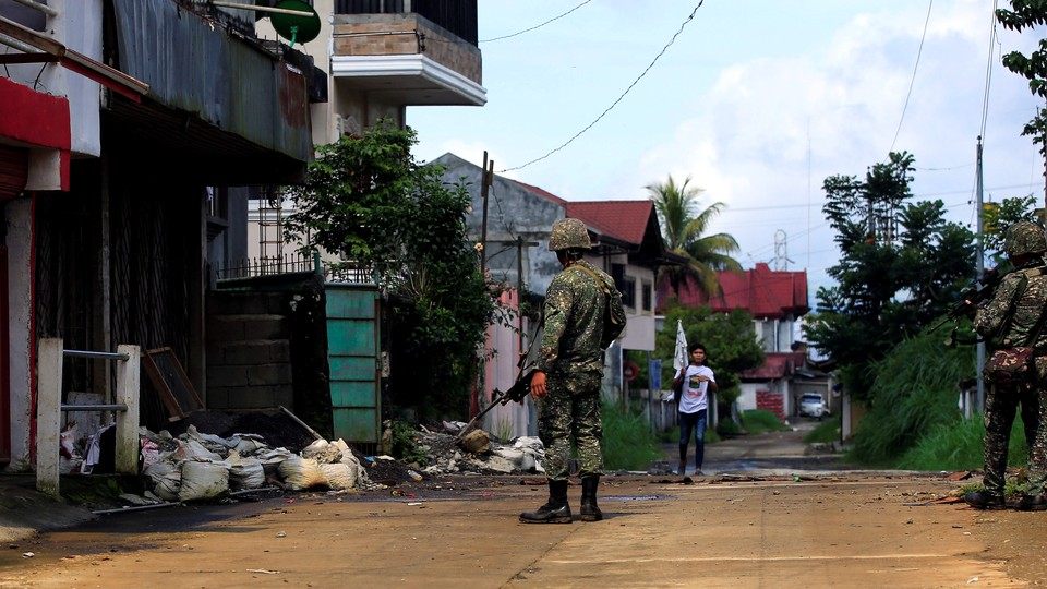 Government soldiers patrol Sarimanok village in Marawi City, which has been overrun by members of theMaute Islamist militant group, on June 1, 2017.