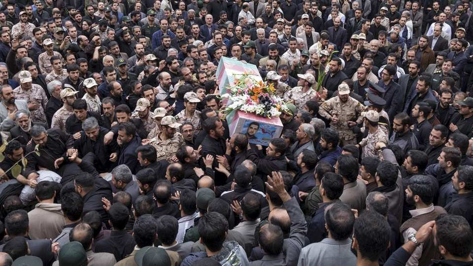 Mourners carry the coffin of an Iranian Revolutionary Guard Corps soldier killed in Syria in 2015.