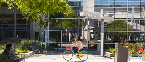 A photo of a Google employee on a bicycle.