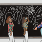 "An illustration of a teacher sitting on a stool, drawing pictures of a civil-rights protest on the chalkboard, while students look on. The protesters signs say ""Education and Justice"" and ""NOW"""