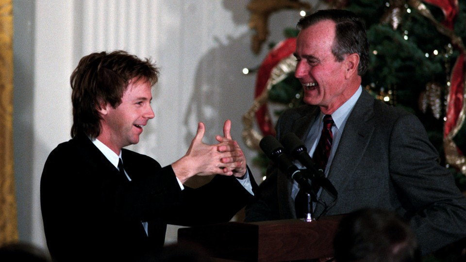 In 1992, the comedian Dana Carvey performs his imitation of President George H. W. Bush in the East Room of the White House.