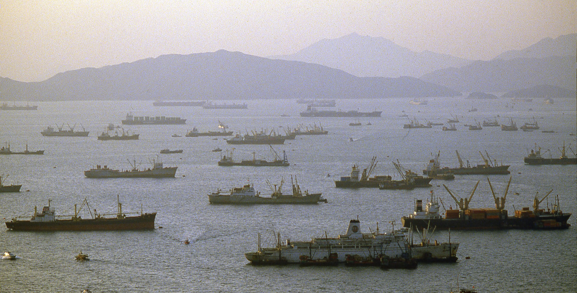An aerial view of cargo ships in Hong Kong harbor.