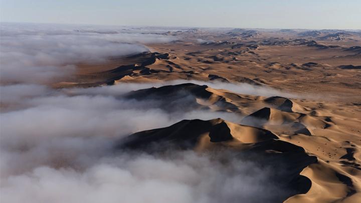 Fog rolling into the dunes of the Namib desert