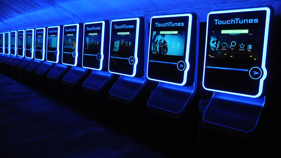 A row of TouchTunes digital jukeboxes