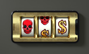 Illustration of smartphone with slot-machine skulls