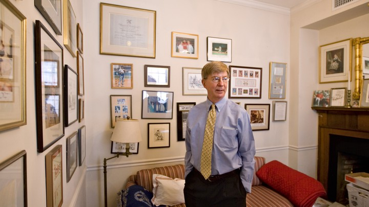 George Will stands in his office.