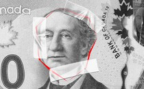 John Macdonald's likeness on the Canadian $10 bill, surrounded by red lines and tape