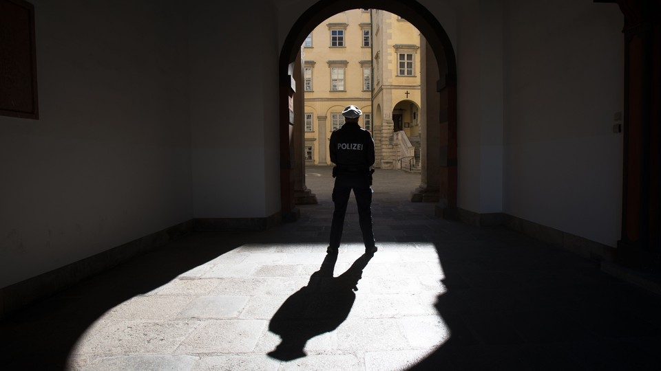 A police officer stands in an archway